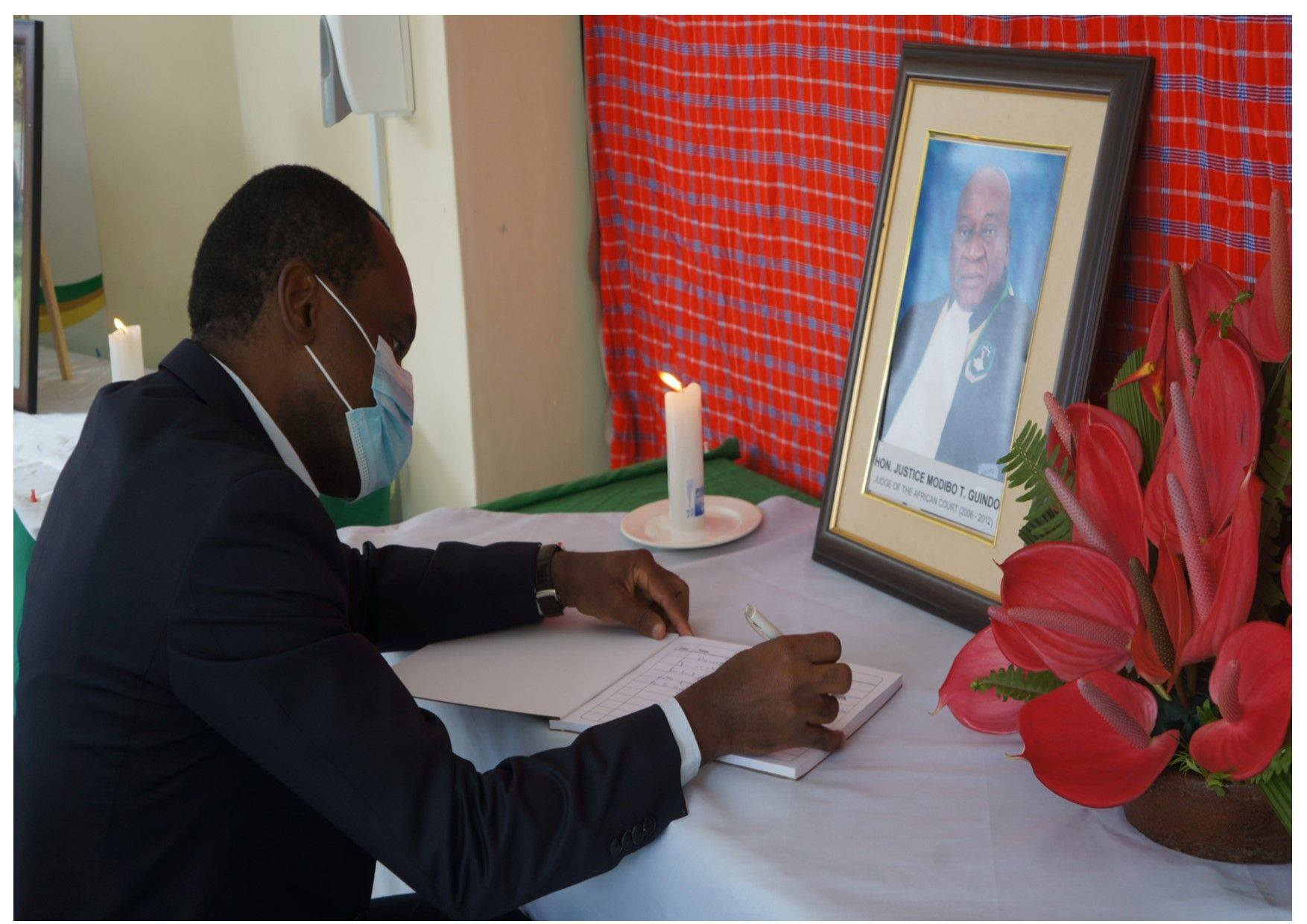 The President of the African Court Justice Sylvain Oré signs a Condolence Book TPresident of the African Court Justice Sylvain Oré signs a Condolence Book